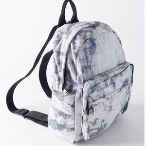 Urban Outfitters grey and white tie dye backpack.